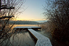 Jetty in snow sunrise Royalty Free Stock Image