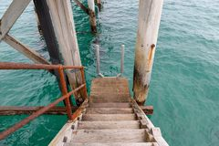 A jetty staircase leading down to the water at Port Noarlunga So. Uth Australia on 23rd August 2018 stock photos