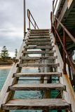 A jetty staircase leading down to the water at Port Noarlunga So. Uth Australia on 23rd August 2018 royalty free stock images