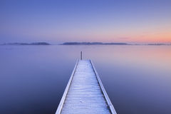 Jetty on a still lake in winter in The Netherlands Royalty Free Stock Photo