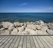 Jetty with stony coast of sea Royalty Free Stock Image