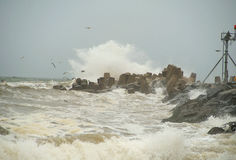 Jetty Storm. Noreaster storm with waves crashing against Manasquan Inlet Jetty stock photos