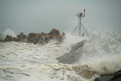 Jetty Storm. Noreaster storm with waves crashing against Manasquan Inlet Jetty royalty free stock photography