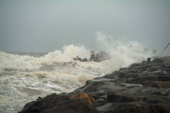 Jetty Storm. Noreaster storm with waves crashing against Manasquan Inlet Jetty Stock Images