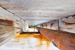Jetty Structure Details: Beam and Pipe Perspective Stock Photo