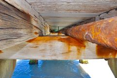 Jetty Structure Details: Beam and Pipe Perspective Royalty Free Stock Photography