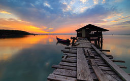 Jetty sunrise over the ocean with fishing boat at Jelutong Expressway, Penang, Malaysia Stock Image