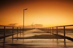 Jetty Sunset. Beautiful sunset over a long jetty Stock Photography