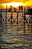 Jetty sunset. Couple enjoying sunset over ocean Stock Images