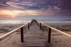 Jetty and sunset at a beach in Sabah, Malaysia Stock Photos