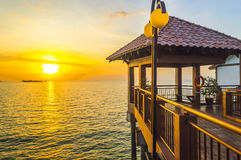Jetty with sunset. Beautiful sunset view facing ocean Royalty Free Stock Photography