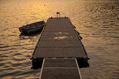 Jetty sunset boat Royalty Free Stock Image