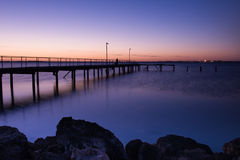 Jetty. At sunset on the cold day Royalty Free Stock Image
