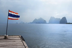 Jetty with Thai Flag. Wooden jetty with Thai flag, Phi Phi Island, Thailand royalty free stock photos