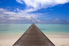 Jetty to the horizon. Endless jetty leading from the beach to the horizon Stock Image