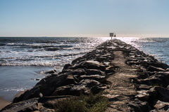 Jetty to Horizon Line. The stone jetty at the Virginia Beach oceanfront Stock Photography