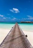 Jetty to Maldivian water villas royalty free stock photography