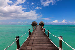 Jetty to ocean huts Stock Photos