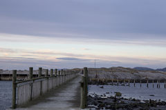 Jetty to the rocky island Royalty Free Stock Images