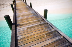 Jetty to a tropical beach. On the maldives Stock Photos