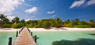 Jetty to a tropical beach. Jetty that leads to a tropical beach Stock Photo