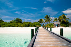 Jetty to a tropical beach. Jetty to a beautiful tropical beach Stock Images