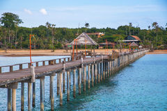 Jetty to a tropical beach Stock Photography