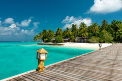 Jetty to a tropical beach. On the maldives Royalty Free Stock Photos