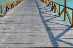 Jetty to a tropical beach Stock Photos