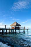 Jetty to an tropical island. Jetty that leads to an tropical island on the maldives Royalty Free Stock Images
