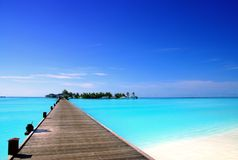 Jetty to an tropical island. Jetty that leads to an tropical island on the maldives Stock Images