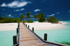 Jetty to an untouched island. On the maldives Royalty Free Stock Photo