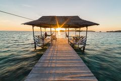 Jetty with tourist at sunrise Stock Photography