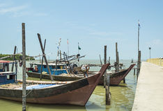Jetty and traditional wooden boat Stock Photography