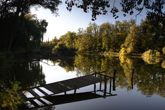 Jetty in a tranquil lake Stock Image