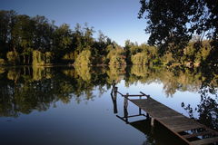 Jetty in a tranquil lake Royalty Free Stock Photo