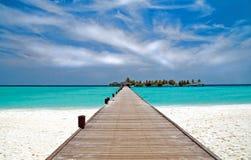 Jetty on a tropical beach Stock Photos