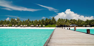 Jetty on a tropical beach. That leads to an beautiful island Stock Photography