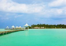 Jetty on a tropical beach at Maldives Stock Photo