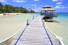 Jetty on tropical beach Royalty Free Stock Images