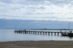 Jetty. Wave clouds Jetty bridge in Australia royalty free stock image