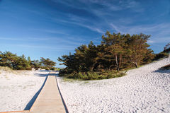 Jetty and white sandy beach on Bornholm Stock Photo