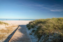 Jetty and white sandy beach on Bornholm Royalty Free Stock Image