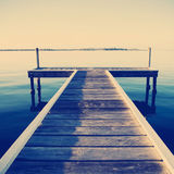 Jetty. Wooden pier or jetty stretches out into an idyllic ocean Royalty Free Stock Images