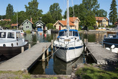 Jettys and boats North harbour Vaxholm Stock Photo