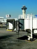 Jetway. At an airport with control tower in the background Royalty Free Stock Photography