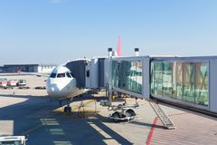 Jetway conecting plane to airport departure gates. Royalty Free Stock Image