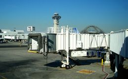 Jetway Seventy-Three. Jetway at an airport with control tower in the background Royalty Free Stock Photo