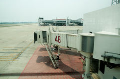 Jetway waiting for a plane to arrive. On airport Royalty Free Stock Images