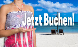 Jetzt buchen (in german book now) concept is presented by woman Stock Photo